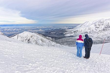 zakopane: People looking into distance in Kasprowy Wierch in Zakopane in winter. Zakopane is a town in Poland in Tatra Mountains.Kasprowy Wierch is a mountain in Zakopane and the most popular ski area in Poland