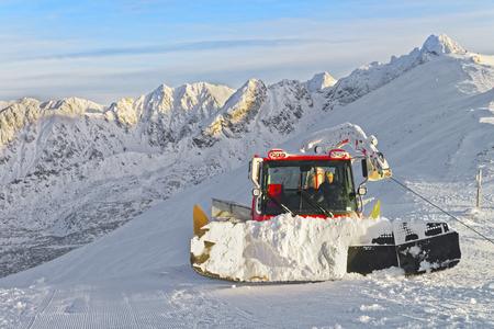 snowcat: Ratrack at work on Kasprowy Wierch in Zakopane in winter. Zakopane is a town in Poland in Tatra Mountains.Kasprowy Wierch is a mountain in Zakopane and the most popular ski area in Poland