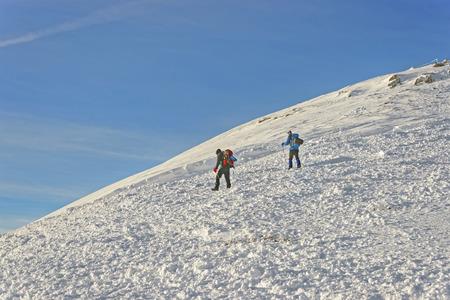 zakopane: People climbing atop of Kasprowy Wierch in Zakopane in winter. Zakopane is a town in Poland in Tatra Mountains. Kasprowy Wierch is a mountain in Zakopane and the most popular ski area in Poland