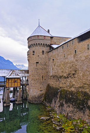 lac: VEYTAUX, SWITZERLAND - JANUARY 2, 2015: Front towers of Chillon Castle. It is an island castle on Lake Geneva (Lac Leman) in the Vaud canton, between Montreux and Villeneuve. Editorial