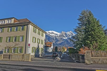 st gallen: Street view and Alps in the Town of Bad Ragaz. Bad Ragaz is a city in canton St. Gallen in Switzerland.  It lies over Graubunden Alps. Spa and recreation village is at end of Tamina valley
