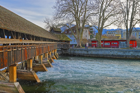 winter wood: Fragment of Old Wooden Sluice bridge in the Old Town of Thun. Thun is a city in Swiss canton of Bern, where Aare river flows out of Lake Thun.