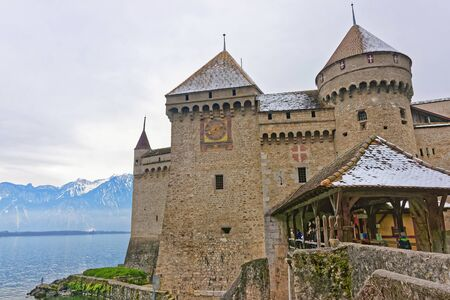 convict lake: VEYTAUX, SWITZERLAND - JANUARY 2, 2015: Entrance to the Chillon Castle. It is an island castle on Lake Geneva (Lac Leman) in the Vaud canton, between Montreux and Villeneuve. Editorial