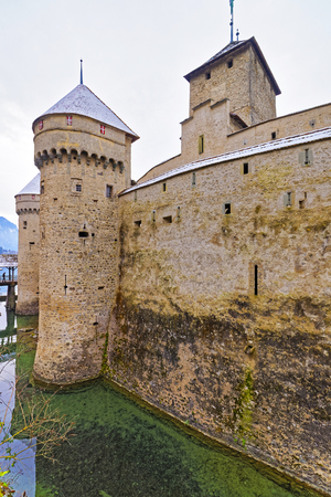 convict lake: VEYTAUX, SWITZERLAND - JANUARY 2, 2015: Front tower of Chillon Castle. It is an island castle on Lake Geneva (Lac Leman) in the Vaud canton, between Montreux and Villeneuve.