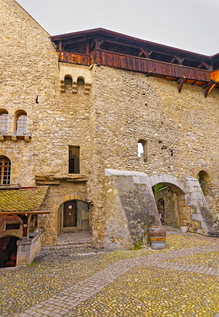 convict lake: VEYTAUX, SWITZERLAND - JANUARY 2, 2015: View to Courtyard of Chillon Castle in Switzerland. It is an island castle on Lake Geneva (Lac Leman) in the Vaud, between Montreux and Villeneuve. Editorial