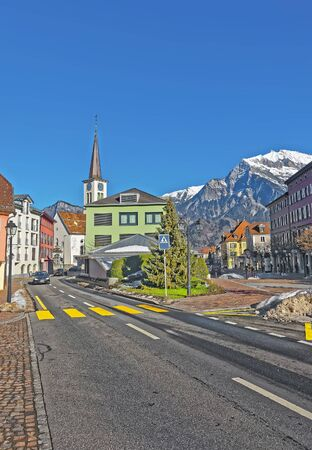 st gallen: Catholic Church and Mountains in City of Bad Ragaz. Bad Ragaz is a city in canton St. Gallen in Switzerland.  It lies over Graubunden Alps. Spa and recreation village is at end of Tamina valley