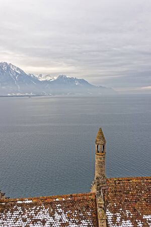 convict lake: VEYTAUX, SWITZERLAND - JANUARY 2, 2015: View to Geneva Lake from the Chillon Castle. It is an island castle on Lake Geneva (Lac Leman) in the Vaud, between Montreux and Villeneuve.