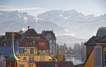 monch: Panorama of Houses in Thun and the Alps and Thunersee. Thun is a city in the canton of Bern in Switzerland, where the Aare river flows out of Lake Thun. There is a view of Bernese Alps.