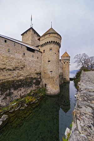 convict lake: VEYTAUX, SWITZERLAND - JANUARY 2, 2015: Defense Towers of Chillon Castle. It is an island castle on Lake Geneva (Lac Leman) in the Vaud canton, between Montreux and Villeneuve.