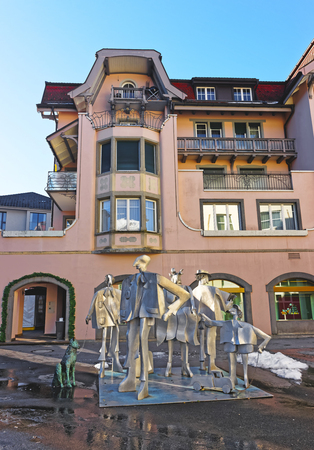 st gallen: BAD RAGAZ, SWITZERLAND - JANUARY 5, 2015: People composition statue. Bad Ragaz is a city in the St. Gallen in Switzerland, over the Graubunden Alps. The Spa and recreation village is at Tamina valley Editorial