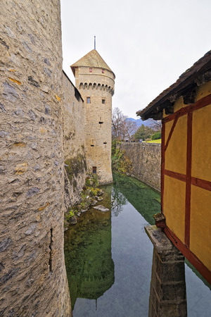 montreux: VEYTAUX, SWITZERLAND - JANUARY 2, 2015: Tower of Chillon Castle. It is an island castle on Lake Geneva (Lac Leman) in the Vaud canton, between Montreux and Villeneuve.