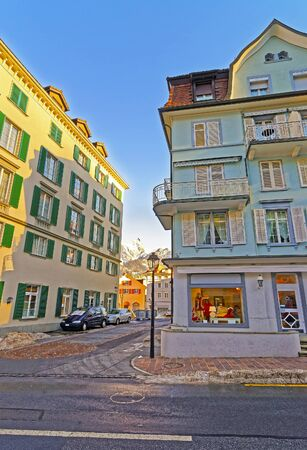 st gallen: Houses and the Alps in the City of Bad Ragaz. Bad Ragaz is a city in canton St. Gallen in Switzerland.  It lies over Graubunden Alps. Spa and recreation village is at end of Tamina valley