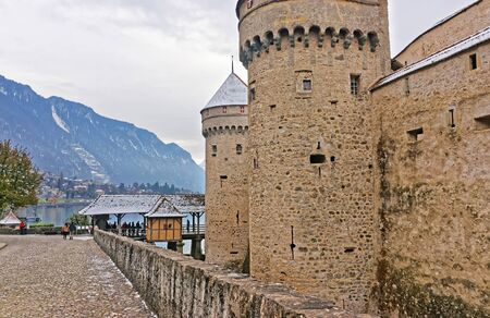 convict lake: VEYTAUX, SWITZERLAND - JANUARY 2, 2015: Towers of Chillon Castle. It is an island castle on Lake Geneva (Lac Leman) in the Vaud canton, between Montreux and Villeneuve.