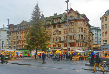 BASEL, SWITZERLAND - JANUARY 1, 2014: Street view of Marktplatz in the Old City of Basel. Basel is a third most populous city in Switzerland. It is located on the river Rhine. Zdjęcie Seryjne - 51729285