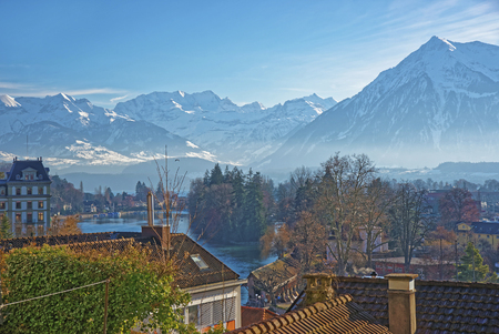 monch: Panorama of the Town of Thun with Thunersee and the Alps. Thun is a city in the canton of Bern in Switzerland, where the Aare river flows out of Lake Thun. There is a view of Bernese Alps.