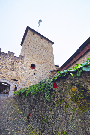 VEYTAUX, SWITZERLAND - JANUARY 2, 2015: Gate Tower in Inner Court of the Chillon Castle in Switzerland. It is an island castle on Lake Geneva (Lac Leman) in the Vaud, between Montreux and Villeneuve.