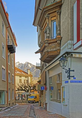 st gallen: Street view and the Alps in the City of Bad Ragaz. Bad Ragaz is a city in canton St. Gallen in Switzerland.  It lies over Graubunden Alps. Spa and recreation village is at end of Tamina valley