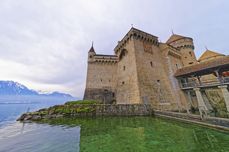 convict lake: VEYTAUX, SWITZERLAND - JANUARY 2, 2015: Facade of the Chillon Castle. It is an island castle on Lake Geneva (Lac Leman) in the Vaud canton, between Montreux and Villeneuve.