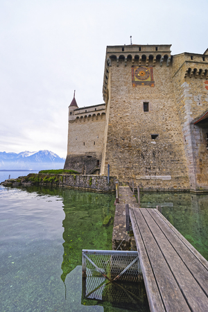 VEYTAUX, SWITZERLAND - JANUARY 2, 2015: Clock tower of the Chillon Castle. It is an island castle on Lake Geneva (Lac Leman) in the Vaud canton, between Montreux and Villeneuve.