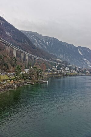 montreux: Long bridge above Montreux city center in winter. Montreux is a city in the canton of Vaud in Switzerland. It is located on Lake Geneva at the foot of the Alps. Stock Photo