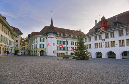 town hall square: Town Hall Square with a Christmas tree in the Old City of Thun. Thun is a city in Swiss canton of Bern, where Aare river flows out of Lake Thun. Town Hall Square is a historic center of the city