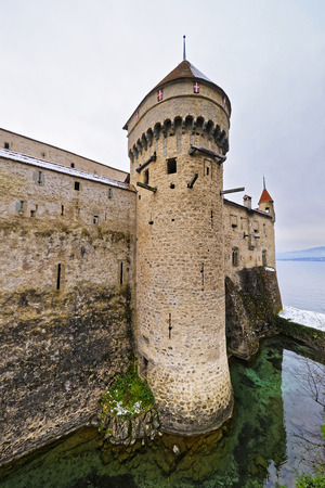 leman: VEYTAUX, SWITZERLAND - JANUARY 2, 2015: Defence Tower of Chillon Castle. It is an island castle on Lake Geneva (Lac Leman) in the Vaud canton, between Montreux and Villeneuve.