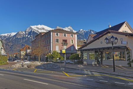 st gallen: Street view and the Alps in the Town of Bad Ragaz. Bad Ragaz is a city in canton St. Gallen in Switzerland.  It lies over Graubunden Alps. Spa and recreation village is at end of Tamina valley