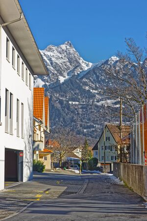 st gallen: Street view on the Alps in the Town of Bad Ragaz. Bad Ragaz is a city in canton St. Gallen in Switzerland.  It lies over Graubunden Alps. Spa and recreation village is at end of Tamina valley