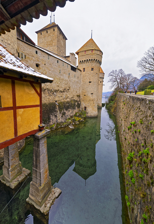 convict lake: VEYTAUX, SWITZERLAND - JANUARY 2, 2015: View to Chillon Castle from its Entrance. It is an island castle on Lake Geneva (Lac Leman) in the Vaud, between Montreux and Villeneuve. Editorial