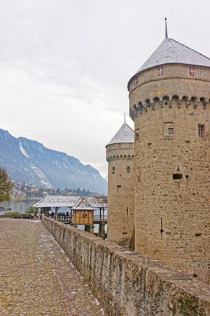 VEYTAUX, SWITZERLAND - JANUARY 2, 2015: Towers of Chillon Castle. It is an island castle on Lake Geneva (Lac Leman) in the Vaud canton, between Montreux and Villeneuve.