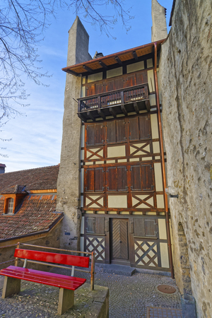 out of town: House with Timber Framing in the Old Town of Thun. Thun is a city in Swiss canton of Bern, where Aare river flows out of Lake Thun. Town Hall Square is a historic center of the city