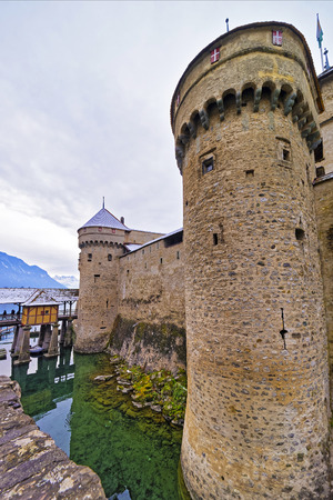 convict lake: VEYTAUX, SWITZERLAND - JANUARY 2, 2015: Front towers of the Chillon Castle. It is an island castle on Lake Geneva (Lac Leman) in the Vaud canton,between Montreux and Villeneuve.