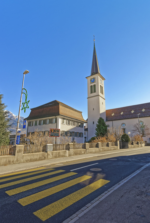 st gallen: Catholic Church in the Town of Bad Ragaz. Bad Ragaz is a city in canton St. Gallen in Switzerland.  It lies over Graubunden Alps. Spa and recreation village is at end of Tamina valley Stock Photo