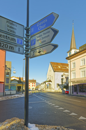 st gallen: Road sign and Catholic Church in Bad Ragaz. Bad Ragaz is a city in canton St. Gallen in Switzerland.  It lies over Graubunden Alps. Spa and recreation village is at end of Tamina valley Stock Photo