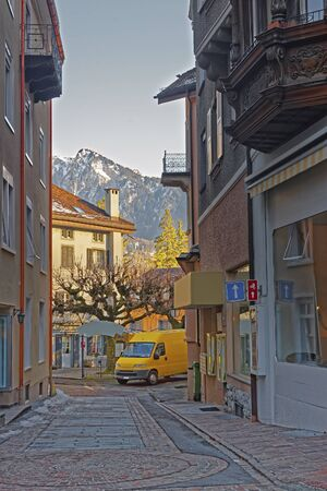 st gallen: Street view and Alps in the City of Bad Ragaz. Bad Ragaz is a city in canton St. Gallen in Switzerland.  It lies over Graubunden Alps. Spa and recreation village is at end of Tamina valley Stock Photo
