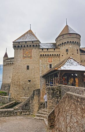 convict lake: VEYTAUX, SWITZERLAND - JANUARY 2, 2015: Entrance to Chillon Castle. It is an island castle on Lake Geneva (Lac Leman) in the Vaud canton, between Montreux and Villeneuve. Editorial