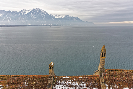 convict lake: VEYTAUX, SWITZERLAND - JANUARY 2, 2015: Lake Geneva View from the Chillon Castle. It is an island castle on Lake Geneva (Lac Leman) in the Vaud, between Montreux and Villeneuve.