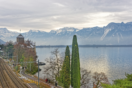 convict lake: View to Chillon Castle from the bridge. It is an island castle on Lake Geneva (Lac Leman) in the Vaud, between Montreux and Villeneuve. It is among the most visited castles in Switzerland and Europe Editorial