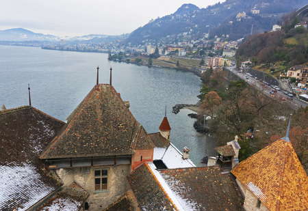 lac: VEYTAUX, SWITZERLAND - JANUARY 2, 2015: View to Montreux from the Chillon Castle. It is an island castle on Lake Geneva (Lac Leman) in the Vaud, between Montreux and Villeneuve.