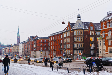 municipal court: COPENHAGEN, DENMARK - JANUARY 5, 2011: Street view to Copenhagen City Hall Tower in winter. It is the headquarters of the municipal council. The building is situated in central Copenhagen, Denmark