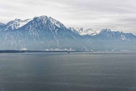 vevey: Panoramic view to Lake Geneva from Montreux city in Switzerland in the evening in winter. Lake Geneva is a lake on the north side of the Alps, shared between Switzerland and France.