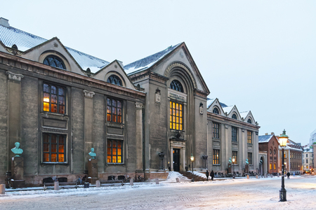 View of University of Copenhagen Main Building in winter. The University of Copenhagen is the oldest university and research institution in Denmark. It was founded in 1479. Publikacyjne