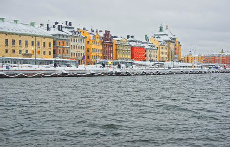 Waterfront of the Old City of Stockholm in the evening in winter Stock Photo