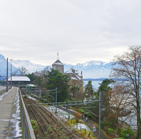 convict lake: VEYTAUX, SWITZERLAND - JANUARY 2, 2015: View to the Chillon Castle from a bridge. It is an island castle on Lake Geneva (Lac Leman) in the Vaud, between Montreux and Villeneuve.