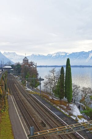 convict lake: VEYTAUX, SWITZERLAND - JANUARY 2, 2015: View to the Chillon Castle from the bridge. It is island castle on Lake Geneva (Lac Leman) in the Vaud, between Montreux and Villeneuve. Editorial