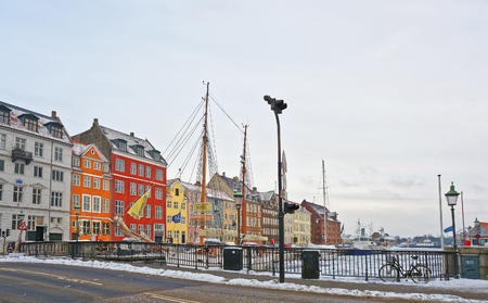 entertainment district: COPENHAGEN, DENMARK - JANUARY 5, 2011: Nyhavn (New Harbor)in winter. It is waterfront, canal, entertainment district of Copenhagen, Denmark. It is lined by colored houses, bars, cafes, wooden ships