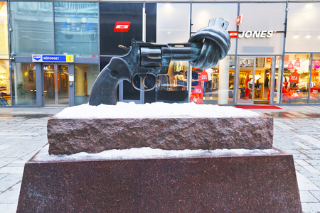 nonviolence: STOCKHOLM, SWEDEN - JANUARY 5, 2011: Non-Violence statue of twisted gun in winter Stockholm. Stockholm is the capital of Sweden and the most populous city in the Nordic region. Editorial