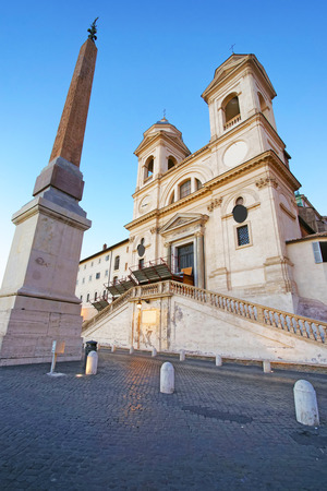 obelisk stone: Church of Trinita dei Monti and Egyptian obelisk in Rome in Italy. It is a Roman Catholic and Renaissance church near the Spanish Steps leading to the Piazza di Spagna, that is the Square of Spain.
