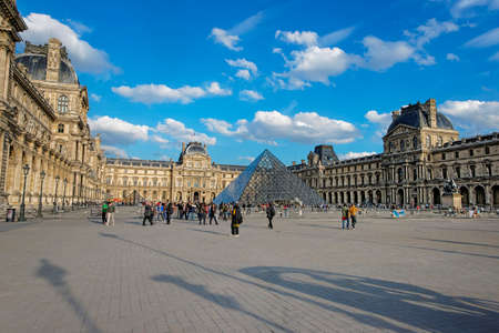 louvre pyramid: PARIS, FRANCE - MAY 3, 2012: Louvre Pyramid and Louvre Palace in Paris in France.  Palace of Louvre is a former royal palace and now is a museum. Louvre Pyramid is a large metal and glass pyramid