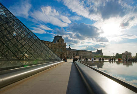 louvre pyramid: PARIS, FRANCE - MAY 3, 2012: View from Louvre Pyramid to Louvre Palace in Paris in France. Palace of Louvre now is a museum. Louvre Pyramid is a large metal and glass pyramid Editorial